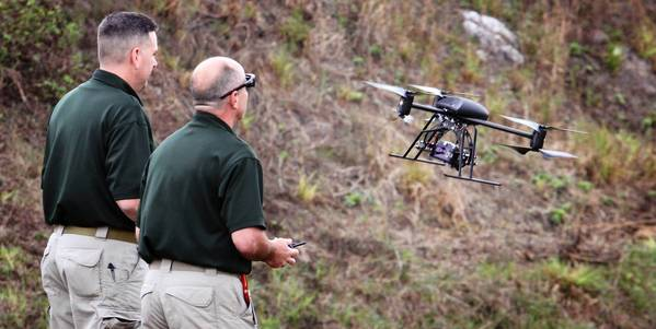 OCSO corporal Jason Robbins and Unmanned Aerial Systems pilot Glenn Miller demonstrate the Dragonflyer X6 drone, during a press conference with Sheriff Jerry Demings, at the sheriff's office gun range in southeast Orange count on Jan. 18, 2012.