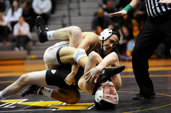 Darian Cruz of Becahi tries to roll Saucon Valley's Bryan Israel over during the 120 pound matchup of the 2013 District 11 class AA wrestling duals held at Freedom High School on Saturday February 2, 2013.