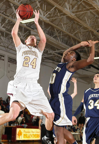 Sterling Fortune of Poquoson get the shot past Jaquan Hays of Lafayette during the second half Wednesday at Poquoson.