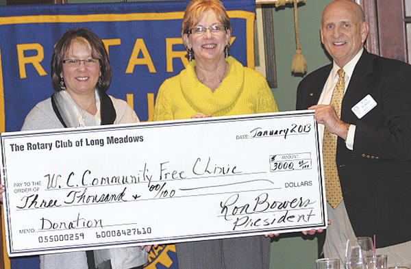 Donna Long, left, treasurer of The Rotary Club of Long Meadows, and Ron Bowers, right, president of the club, present a $3,000 check to Robin Roberson, executive director of the Community Free Clinic of Washington County.