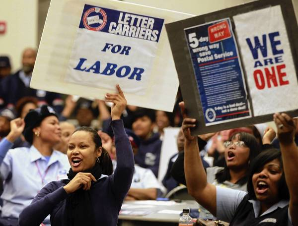 U.S. Postal workers rally at the National Association of Letter Carriers Chicago Local Branch 11 on the South Side. They were denouncing the announcement made today by the Postal Service to drop Saturday delivery of first-class mail by August.