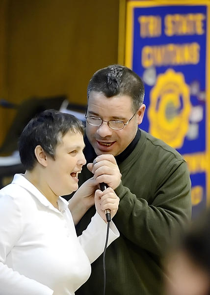 Debbie Matthews, left, of Boonsboro, and Joe Ferarelli of Hagerstown sing together on Wednesday during Karaoke Night at Trinity Evangelical Lutheran Church in Hagerstown.
