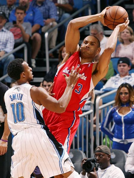 Los Angeles forward Grant Hill (33) passes around Orlando guard Ish Smith (10) during the Los Angeles Clippers at Orlando Magic NBA game at the Amway Center in Orlando