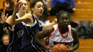 Girls hoops | No. 2 Young too much for No. 7 Trinity