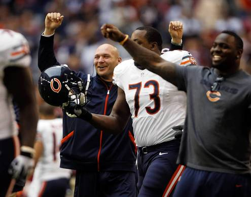Brian Urlacher celebrates Charles Tillman's touchdown in the third quarter against the Cardinals.