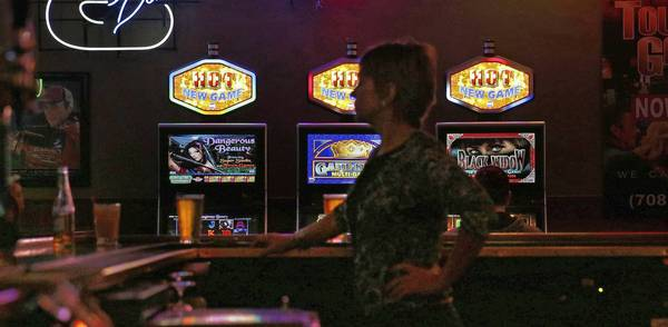Video poker machines are tucked into a corner of Murphy's Law Bar & Grill in Oak Lawn, a suburb that reversed its ban on the games.