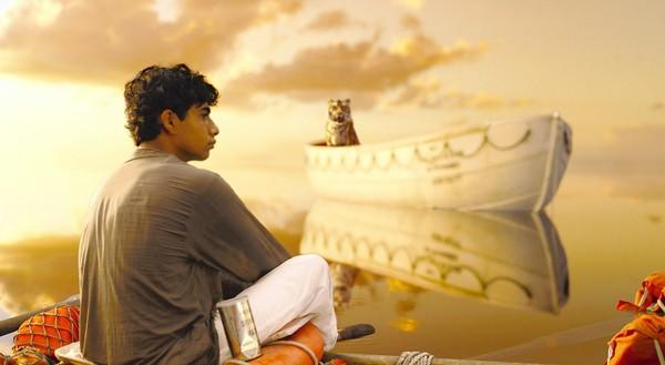 "Suraj Sharma and a Bengal tiger known as Richard Parker arrive at an uneasy detente in director Ang Lee's ""Life of Pi."""