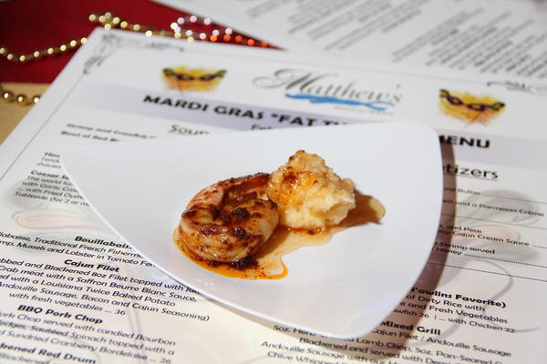 A tasting of BBQ shrimp with cheddar grits was offered by Matthew's Restaurant, 55 Mill St., Unionville, at The Greater Hartford Arts Council's annual Big Red for the Arts food and wine tasting fundraiser Wednesday night, Feb. 6, at The Society Room of Hartford, 31 Pratt St., Hartford.