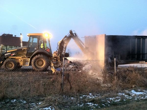 The container of a trash truck smolders after it caught fire on I-78 westbound at Route 100 early Thursday morning.