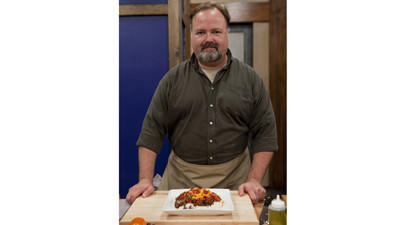 "Tim Burger is shown with his ""Okinawa style"" taco meat over rice, as seen on Food Network's ""Worst Cooks in America,"" season 4."