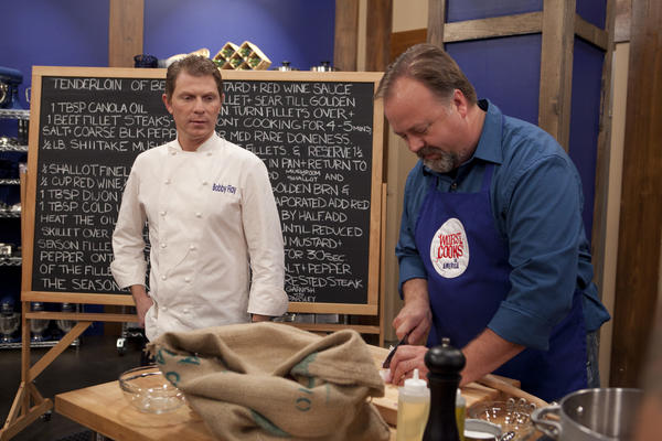 "Chef Bobby Flay (left) talks to former Petoskey resident Tim Burger while he works on Flay's recipe for tenderloin of beef with a mushroom, mustard and red wine sauce as well as buttermilk-bacon smashed potatoes or roasted red potatoes or Yukon gold hash. Burger is a contestant on this season's ""Worst Cooks in America"" on the Food Network. The show premieres Sunday, Feb. 17."