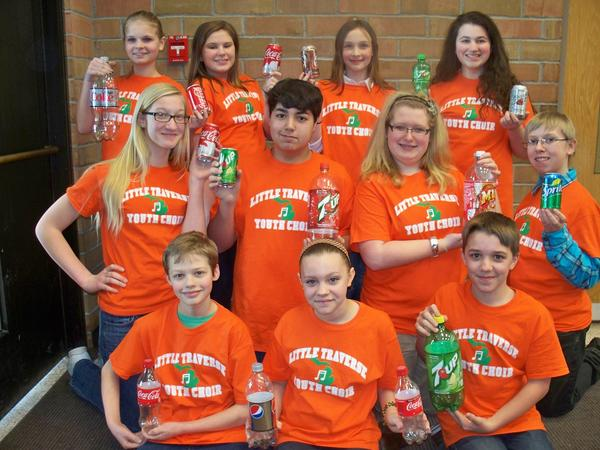 Members of the Little Traverse Youth Choir, including (front row, from left) Tyler Spychalski, Sarah Kesseler, Jordan Hull; (middle row) Hannah Watton, Alex Esterline, Abby Norman, Brendon Egolf; (back row) Milla Tarvudd, Cassie Sommerfield, Marion Watson and Emma Montel, will be collecting empty cans and bottles to fund their upcoming Canadian concert tour.