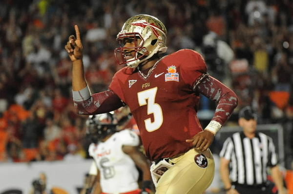 Florida State quarterback EJ Manuel celebrates his touchdown against Northern Illinois during the second half of the Discover Orange Bowl. Manuel was one of 333 players invited to the NFL Comine in Indianapolis. (Jim Rassol/Sun Sentinel/MCT)