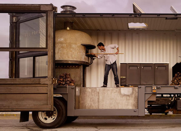 Jon Darsky makes pizza in his repurposed shipping container on a truck.