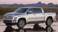 The battle for pickup truck supremacy got a little tighter Thursday as Toyota introduced its redesigned 2014 Tundra full-size truck at the Chicago Auto Show.