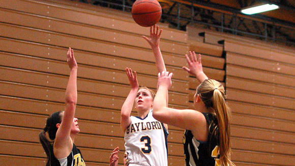 Mackenzie Edwards splits a pair of TC Central defenders during Gaylord's 58-50 victory on Tuesday.