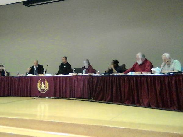 From far left, Superintendent Todd Wernet, board President John Lukasik, Secretary to the Superintendent Gloria Mickulas, board Vice President Lou Ann Johnson, board members Mike Petty and Ronald Svara, Central Campus Principal Kerri Green, and East Campus Principal Dennis Hicks discuss school issues at the Lockport Township High School District 205 board meeting Jan. 28.