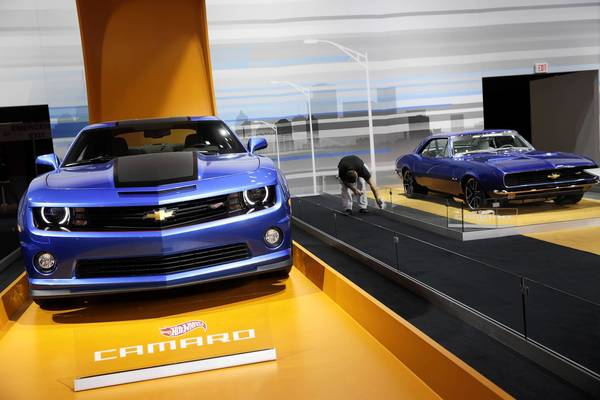 A 2013 Camaro Hot Wheels Special Edition, left, and a 1967 Camaro Concept similar to the 1968 Spectraflame Mattel toy on display at the 105th Chicago Auto Show at McCormick Place.