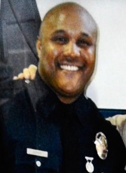 Shooting suspect Christopher Jordan Dorner is pictured in his Los Angeles Police Department uniform. The former cop is suspected three police officers killing one. He is also a suspect in the killings of Monica Quan and Keith Lawrence, who were found dead in a car inside an Irvine parking structure.