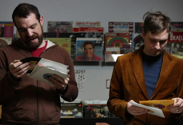 Rob Sevier (left) and Ken Shipley of the Numero Group label flip through singles at the Record Dug Out in Chicago.