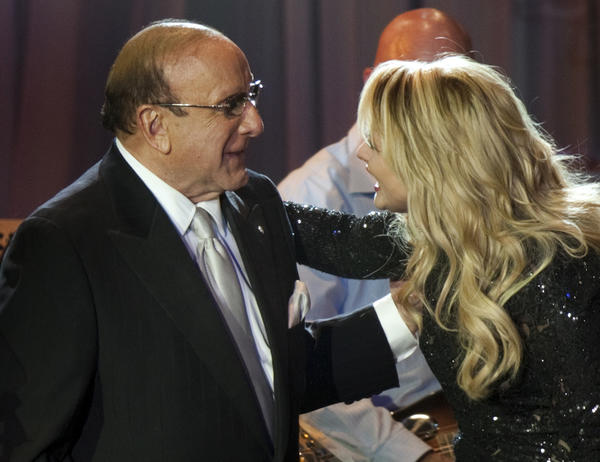 Clive Davis, shown with country singer Miranda Lambert, at his 2012 pre-Grammy Awards party in Beverly Hills