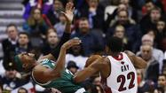 Raptors' Gay commits an offensive foul on Celtics' Pierce during their NBA basketball game in Toronto