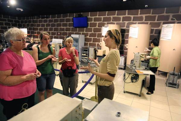 Tour guide at the Chocolate Kingdom, Rebecca Siegel gives visitors samples of chocolate made there. Chocolate Kingdom is the first chocolate museum/attraction/factory in the US where the chocolate will be made from the Tree to the Chocolate Bar.