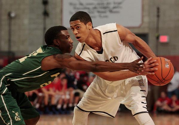 Tyler Dorsey of St. John Bosco protects the ball from Brandon Staton of Long Beach Poly during their game on Feb. 2.