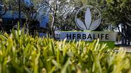 Hedge fund manager Bill Ackman is stepping up his attack against Herbalife Ltd., releasing a 40-page list of questions about how the Los Angeles nutrition company does business.