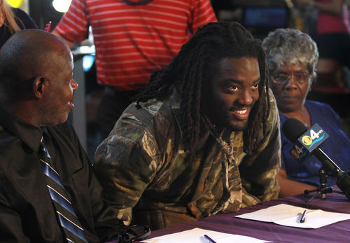 South Plantation Running Back Alex Collins sits down with  father Johnny Collins and his  Grandma Betty Collins to finally sign with Arkansas.