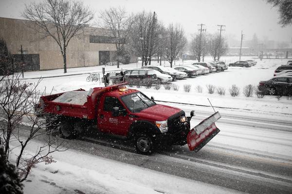 Snow plows begin their work as heavy snowflakes fall in Palatine. A winter storm warning has been issued for Lake and McHenry counties, with heavy wet snow falling at the rate of one to two inches an hour in some northern suburbs.