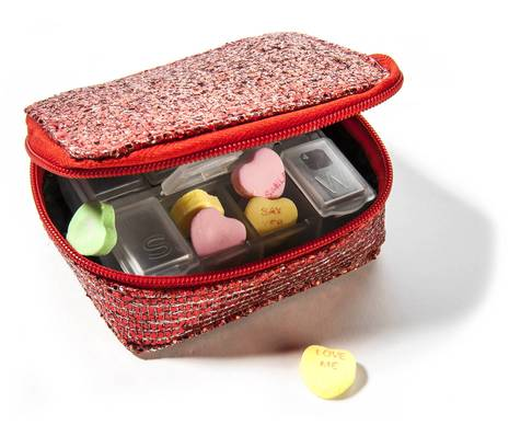 """Instead of aspirin, fill this glittery pill box with candy hearts that do the talking for you, from a heartfelt """"Love Me"""" to the charmingly grade-schoolish """"Hold Hands."""" Pill box, $9.97, Charming Charlie, <a href=""""charmingcharlie.com""""><b>charmingcharlie.com</b></a><br>"""