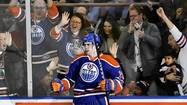 Edmonton Oilers' Schultz celebrates with fans after scoring goal against Dallas Stars during their NHL hockey game in Edmonton