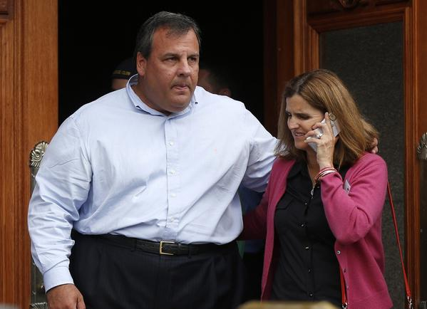 New Jersey Gov. Chris Christie and his wife, Mary Pat Christie,are seen on July 13. Christie responded angrily on Wednesday to a former White House physician's comment that he could die in office if he does not lose weight.