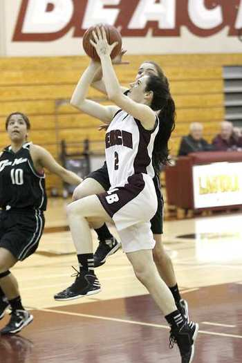 Laguna Beach High's Kyra Humphries drives to the basket for a layup against Costa Mesa on Wednesday.