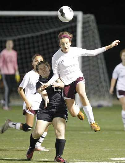 Laguna Beach High's Chiara Noppenberger heads the ball into Costa Mesa territory over the shoulder of Sophie Harriman.