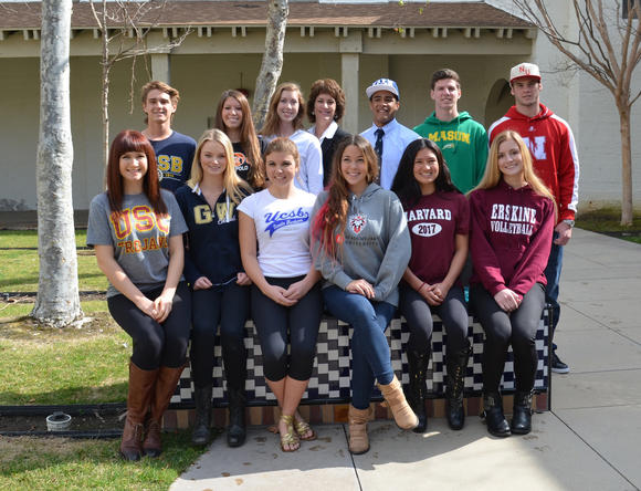 Twelve Laguna Beach High student-athletes signed a National Letter of Intent during National Signing Day Wednesday. The athletes are shown with Laguna Beach Principal Joanne Culverhouse.