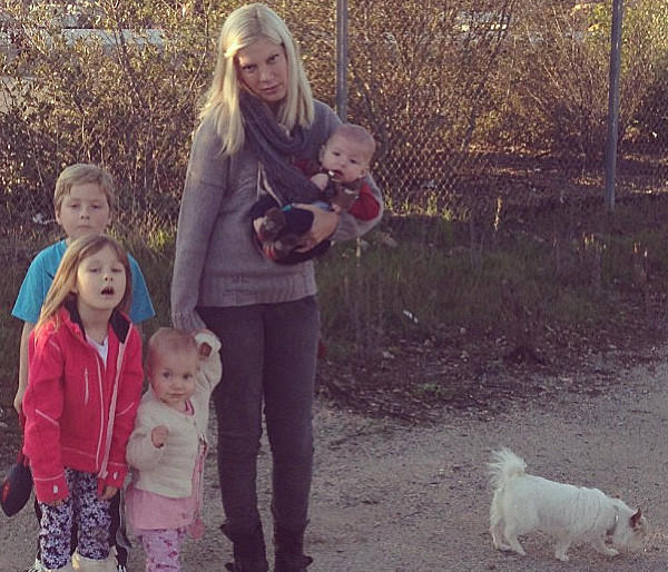 Tori Spelling tweeted this photo of herself stranded with kids Liam, 5, Stella, 4, Hattie, 1, and infant Finn on Wednesday.