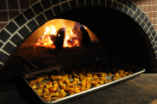 Squash is roasted, an ingredient in the evening special.