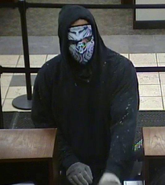 Surveillance photo of a man who robbed a Mount Prospect bank today. Police photo