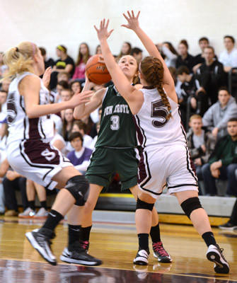 Pen Argyl #3 Devin Presby takes a shot and is defended by Bangor #25 Meredith Colton and #5 Taylor Domenech in their girls basketball game held at Bangor High School on Thursday.