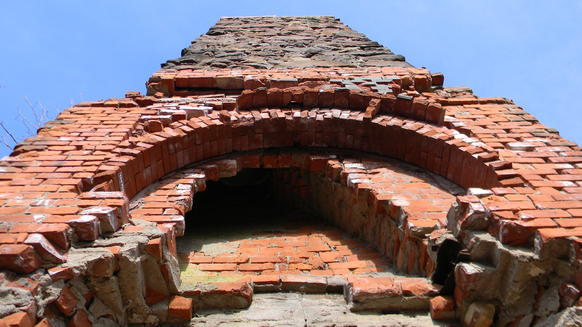 The old fieldstone and brick chimney of Bartlett's Tower remains.