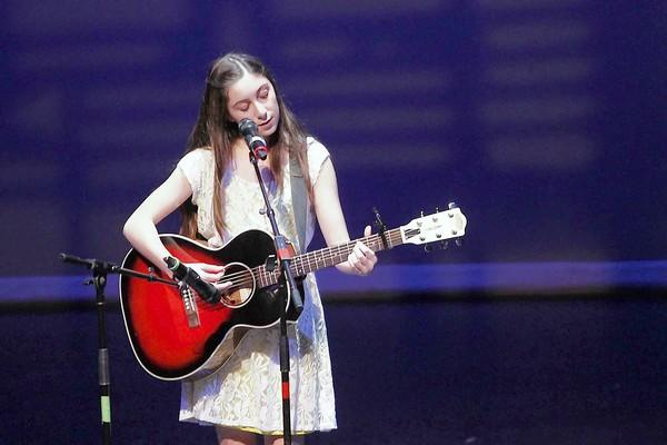 "Rosie Morreale sings ""Mean"" by Taylor Swift at the Thurston Middle School's annual talent show at the Artist's Theatre on Tuesday."