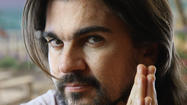 It's official: Juanes, the Colombian pop superstar, will perform at the Grammy Awards show. His presence, though hardly surprising, likely will give the broadcast a ratings boost with Latino viewers.