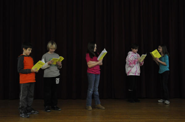 On stage during auditions for the Wizard of Oz. From left, Joe Oliveira, 10, of Newington, Brad Blanchard, 10, of Hartford, Ava Green, 9, of West Hartford, Emma Campbell, 10, of West Hartford, and Mary Charlotte Barnes, 10, of West Hartford audition for the upcoming production of the Wizard of Oz by the Poppins Childrens Theatre Thursday afternoon.