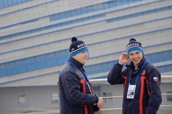 Security staffers keep a close eye on visitors to Shayba Arena, which will host hockey competition during the 2014 Sochi Olympics.