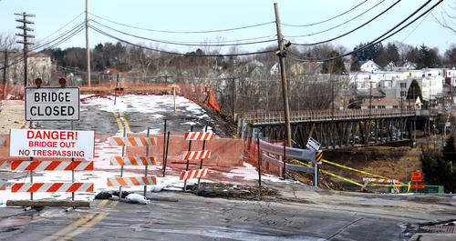Workers from HRI, Inc. continue demolition of the bridge over the Lehigh River from the Hokendauqua area of Whitehall Twp. to North Catasauqua Thursday morning. The bridge is over 100 years old. The new bridge will also carry Lehigh Street over the Ironton Rail-Trail, the Lehigh River and the Lehigh Canal.