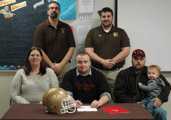 Pellston senior Baylon Kerr (front, middle) signed a National Letter of Intent at Concordia University last week at Pellston High School. Joining Kerr as his signing is (from left) mother Jenny Kerr, Pellston athletic director Tom Basanese, Pellston football coach Ben Schley, father Bill Kerr and brother Jace Kerr.