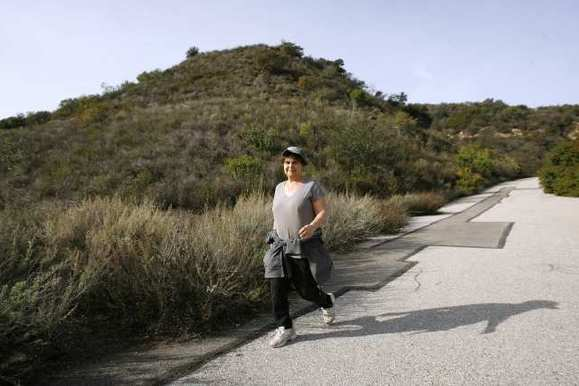 A walker takes a stroll in the hills above Glendale.