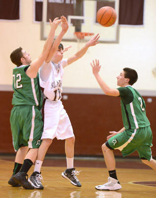 Bangor #10 Michael Martino passes the ball and is defended by Pen Argyl #32 Austin Bender and #2 Chris Muller in their boys basketball game held at Bangor High School on Thursday.